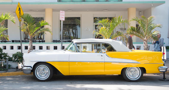 yellow car on ocean drive
